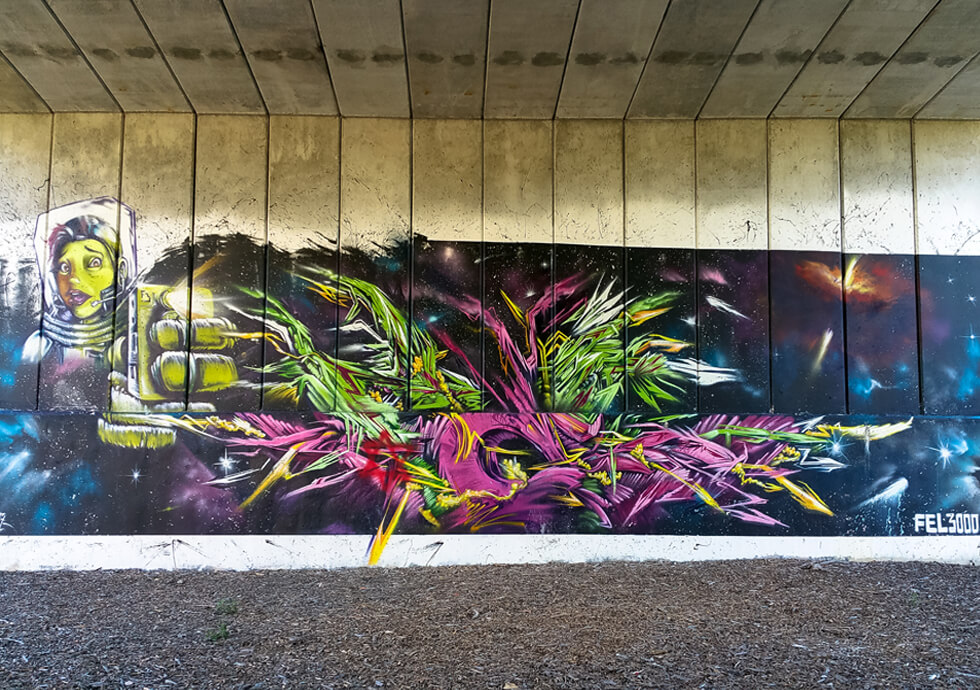 Photograph of a space theme mural by Fel3000ft found on the Dequindre Cut in Detroit.