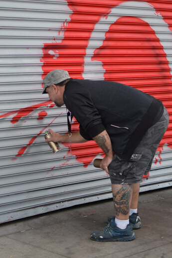 Photograph of Fel3000ft spray painting in Eastern Market