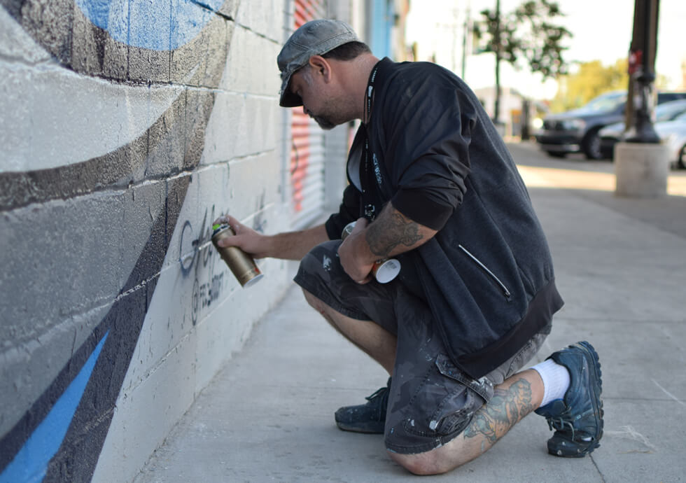 Photograph of Fel3000ft putting the final touches on his latest work